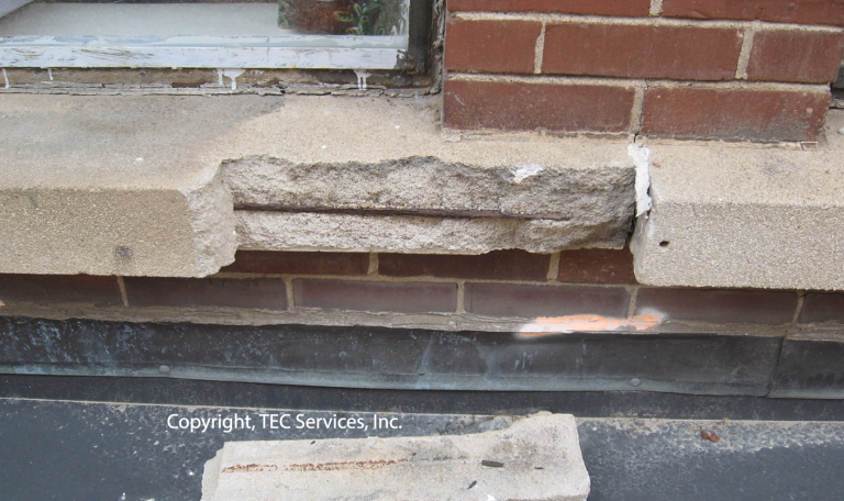 Distressed area at precast masonry window sill